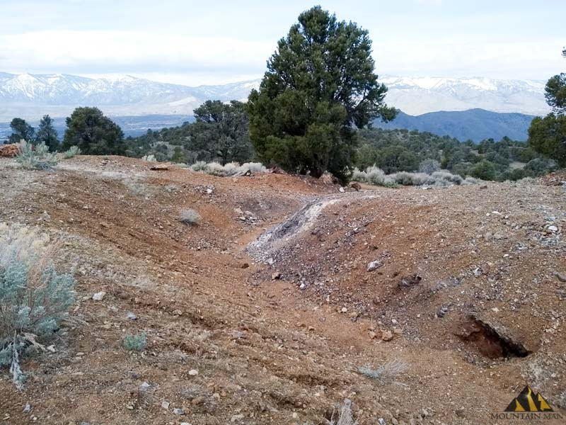 Ravine cut in the tailings pile in front of the main portal at Bunker Hill mine just outside of Carson City, NV.
