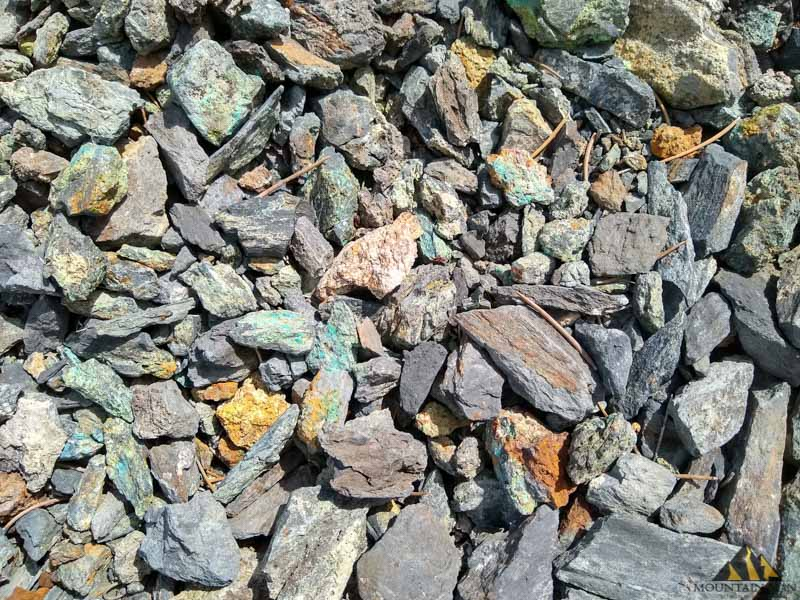 Lots of copper and zinc oxides in the shale on the surface near the main portal at Bunker Hill mine in Carson City, NV.