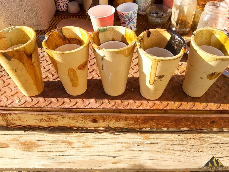 Five gold samples in the crucibles ready to go in the oven.