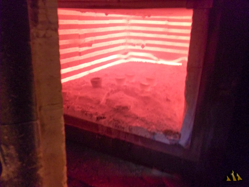 Looking inside the fire assay oven.